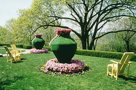 Roberley Bell   Arcadia Now , 2000   real and artificial turf, flowers, and chairs