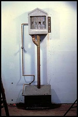 Michael Acker   Fire , 1990   concrete, water, copper, steel, pump, 72 x 18 x 9 inches