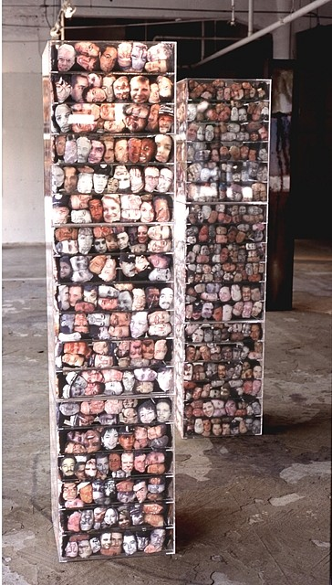Elia Alba   Multiplicities , 2002   plexiglass, photocopy transfer over muslin and thread composed of 1800 unique heads, each tower- 78 x 18 x 18 inches